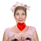 Silly Woman Dressed as a Child holing heart Stock Photography