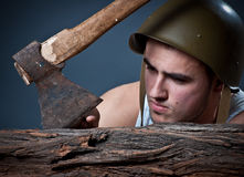 Silly woodcutter cutting a finger by ax Royalty Free Stock Photo