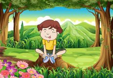 A silly young boy above the stump Royalty Free Stock Image