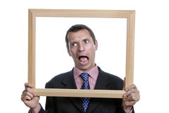 Silly. Young silly business man portrait inside a frame Stock Images