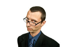 Silly. Young silly businessman portrait isolated on white Royalty Free Stock Photography