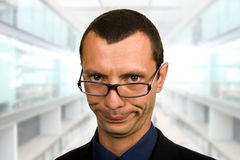 Silly. Young silly businessman portrait at the office Royalty Free Stock Image