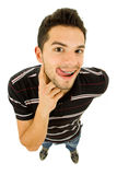 Silly. Young casual silly man full length in a white background Stock Image