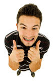 Silly. Young casual silly man full length in a white background Stock Photo