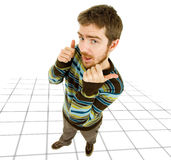 Silly. Young silly casual man going thumbs up Royalty Free Stock Photos