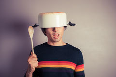 Silly young man with pot on his head Stock Photography