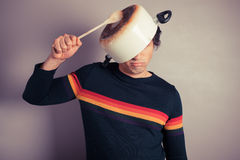 Silly young man with pot on his head Stock Images