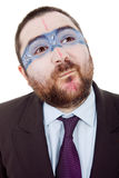 Silly. Young silly man with a strange painted face, isolated Royalty Free Stock Image