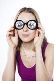 Silly young woman in strange googles Royalty Free Stock Photography