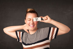 Silly youngster looking with hand drawn eye paper Royalty Free Stock Photos