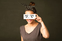 Silly youngster looking with hand drawn eye paper Royalty Free Stock Photography