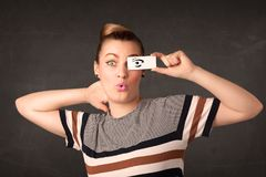 Silly youngster looking with hand drawn eye paper Stock Photos