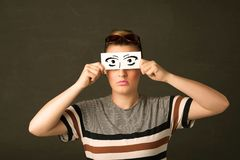 Silly youngster looking with hand drawn eye paper Royalty Free Stock Photo