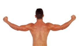 Silna chłopiec pokazuje jego tylnych mięśnie Obraz Royalty Free