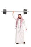 Silny młody Arabski udźwig ciężki barbell Obraz Royalty Free