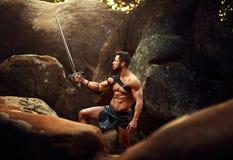 Silny wojownik przy drewnami Obraz Royalty Free