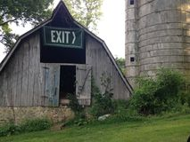 Silo and barn. With exit sign Royalty Free Stock Photos