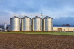 Silo in beautiful landscape with dramatical light. Placed in plouged acres Royalty Free Stock Image