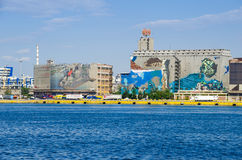 Silo and dry docks  buildings with the wall painting Royalty Free Stock Photo