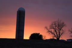 Silo en la puesta del sol Foto de archivo libre de regalías