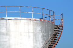 Silo with stairs. And beautiful blue sky in the background royalty free stock photos