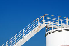 Silo with stairs. And beautiful blue sky in the background royalty free stock images