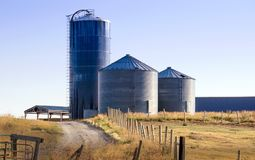 Silo storage tanks on a rural farm in idaho USA Stock Images