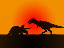 Silohuette of triceratops fighting with t rex Stock Photo
