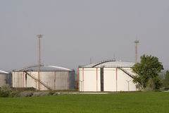 Silos. Two big silos in a green meadow Stock Image
