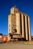 Silos on African farm. Four huge agricultural silos on a South African farm in front of blue sky background Stock Images