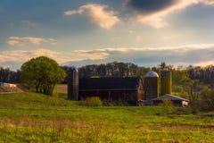 Silos and barn on a farm in rural York County, Pennsylvania. Stock Photography
