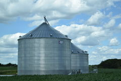 Silos and Blue sky with clouds in Illinois. Silos with blue sky and clouds Royalty Free Stock Photography
