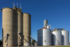 Silos on Blue Sky 2. Large concrete and steel silos on blue sky Royalty Free Stock Image
