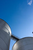 Silos on Blue Sky 6. Silos set against a blue sky Royalty Free Stock Image