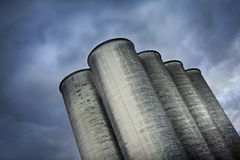 Silos and cloudy sky Stock Image