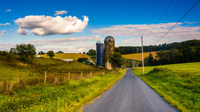 Silos on a country road, in rural York County, Pennsylvania. Stock Images