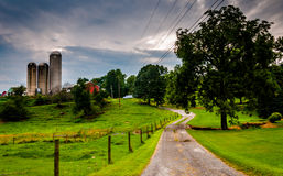 Silos and driveway on a farm in rural Southern York County, Penn Stock Photography