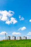 Silos on the field Royalty Free Stock Image