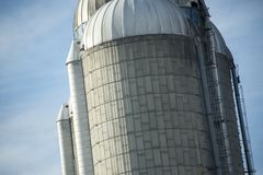 Silos in front of a blue sky stock images