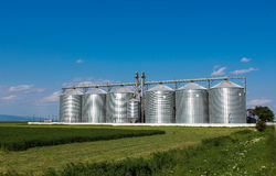 Silos in green field Royalty Free Stock Image