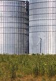 Silos in green landscape Stock Images