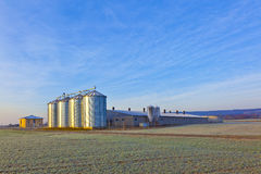 Silos in the middle of a field in wintertime Stock Images