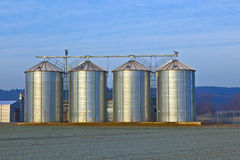 Silos in the middle of a field in wintertime Stock Image