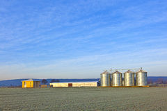 Silos in the middle of a field in wintertime Royalty Free Stock Image