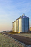 Silos in the middle of a field in wintertime Royalty Free Stock Photography