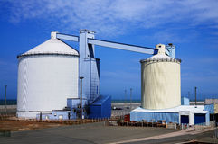Silos in the port of Calais. Two connected silos in the port of Calais, France Stock Photography