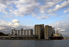 Silos in port near the water Stock Photos
