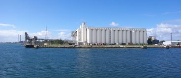 Silos on Riverbank royalty free stock photography