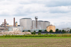 Silos of a suger mill in front of cloudy blue sky after storm Stock Image