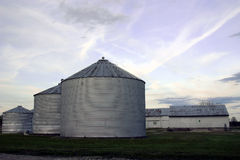 Silos at sunset. 3 silos at sunset, in a rural setting Royalty Free Stock Photo